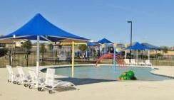 The neighborhood pool and play area in th eSpring Trails subdivision in Pflugerville 78660.