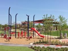 The Bryant Park playscape and pavilion in Easton Park 78744