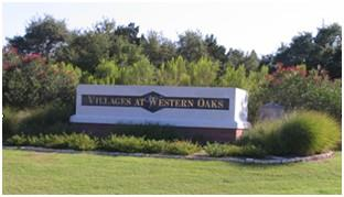 Entry to Villages of Western Oaks at Davis Lane.