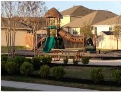 The community playscape in the Meadow Park subdivision in Buda, TX 78660