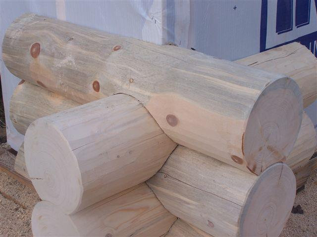 Saddle notch corners, log siding corners,20inch saddle notch logs,large log building calif,utah timber sales, utah saddle notch timbers,whole sale timbers,logs.