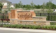 Sign at the Sunfield subdivision entrance in Buda 78660