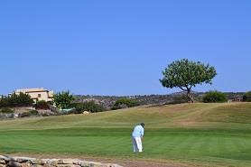 A golfer on a summer day in Aphrodite hills, Cyprus