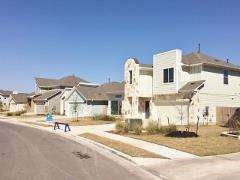 A view of homes and new construction in Addison