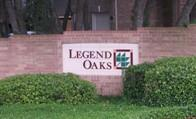 Logo at an entrance to the original Legend Oaks development