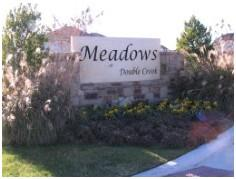 Sign at the entry to the Meadows at Double Creek Austin