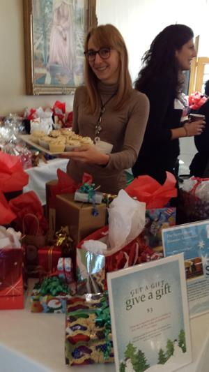 One of Mieke's Alumni holding a platter of my cupcakes at the 2014 Sacred Heart School Christmas Fair.