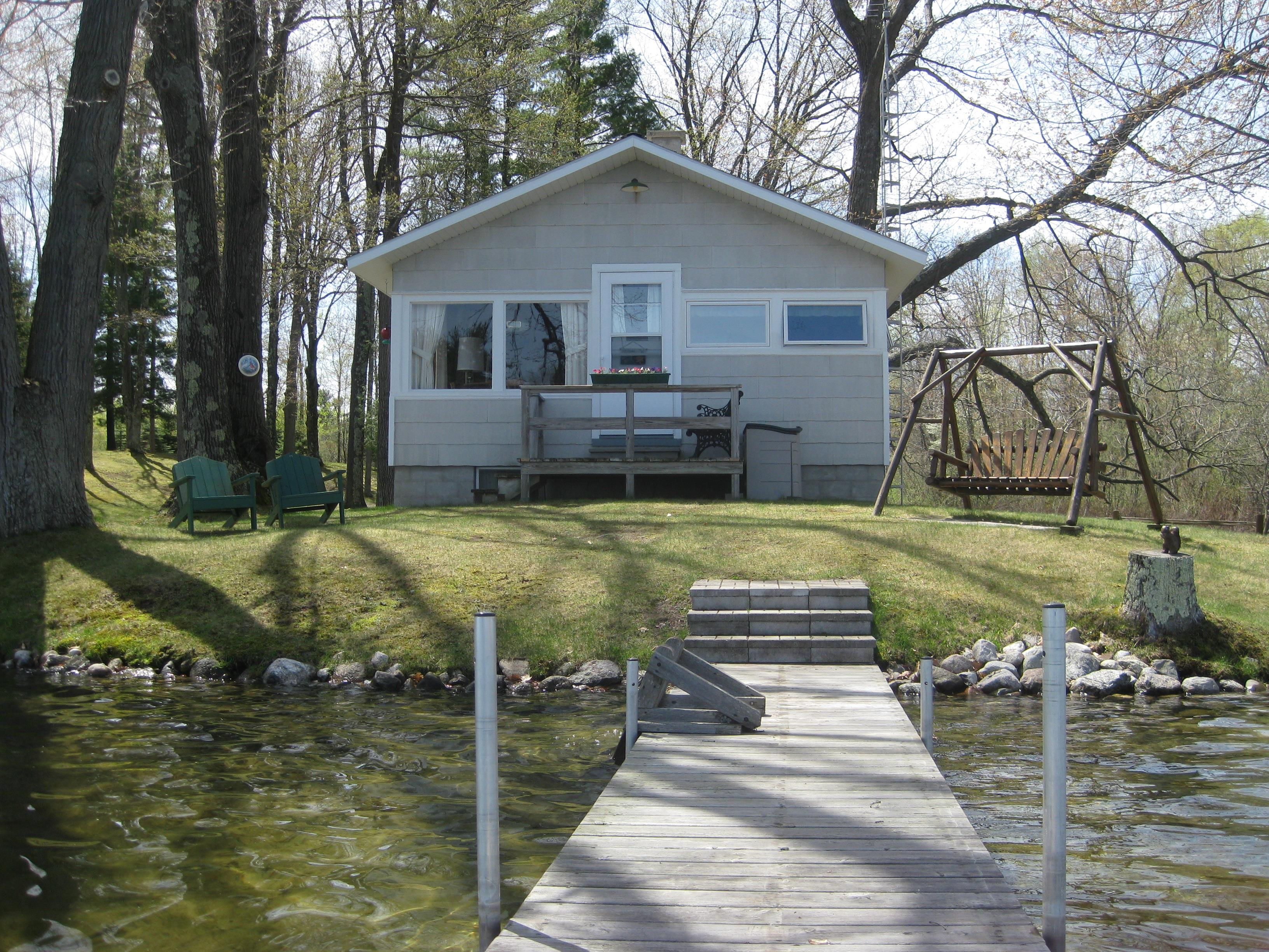 waterfront cottage on acreage for sale on big bass lake near irons