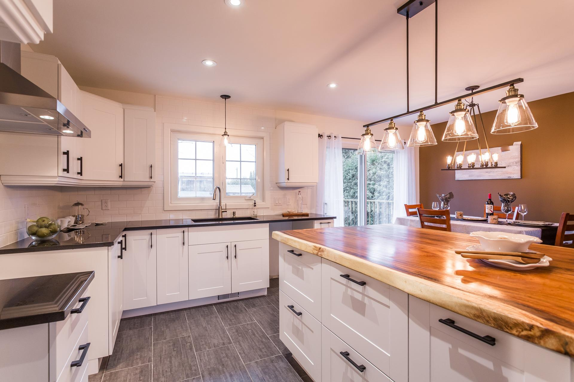 The stunning kitchen with its granit and oiled Acacia-wood countertops in 55 Av. d'Hochelaga, Candiac, Qc J5R 3T9.. Marie Paule Lancup, Realtor.