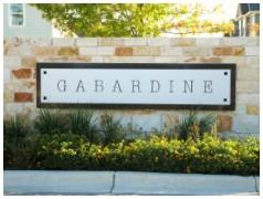 Sign at the entry to the Gabardine Cottage Homes in South Austin 78748.