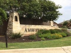 Sign at one of the main entrances to Kyle's Amberwood subdivision 78640