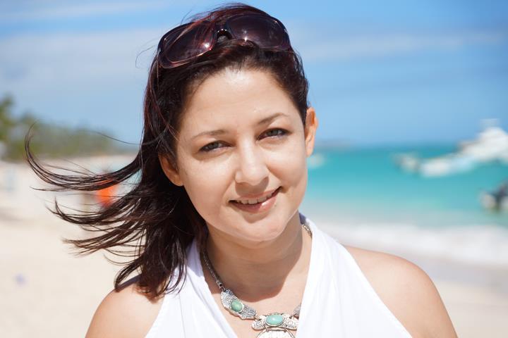 Jocelyn Hernandez on teh beach in Punta Cana filming House Hunters International