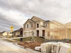 A view of homes and new construction in Vista Point 78744