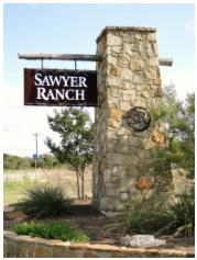 Sign at the front of Sawyer Ranch at US-290W
