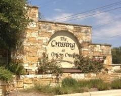 Sign at the entry to the Crossing at Onion Creek subdivision in Austin
