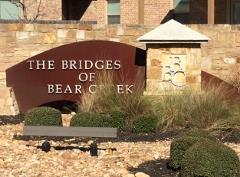 Sign at the entrance to the Bridges at Bear Creek subdivision in South Austin.