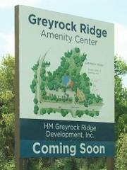 Sign announcing the planned Greyrock Ridge Amenity Center