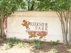 The sign at the entrance to the Creekside Park subdivision in Buda, TX