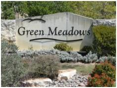 The neighborhood entry at Green Meadows Buda.