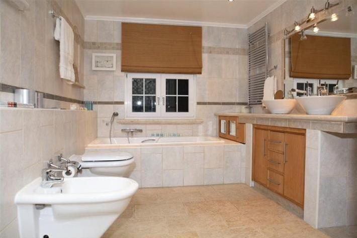 Clean, spacious and decluttered bathroom at Akouros Villa in Paphos