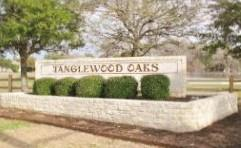 Sign at the entrance to Tanglewood Oaks in South Austin 78748.