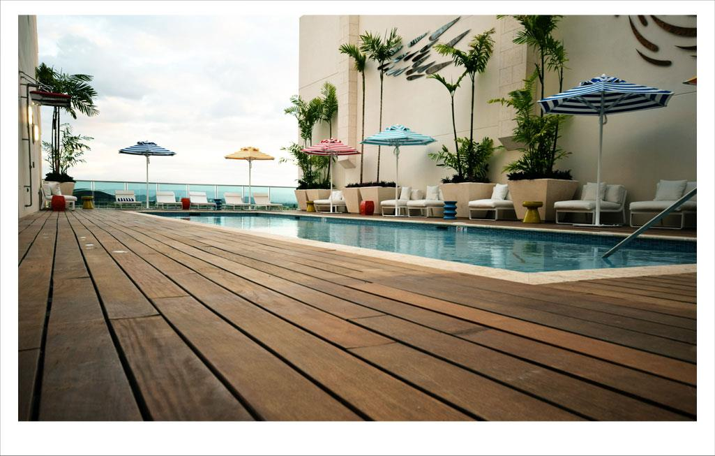 This is a picture of a beautiful pool with an ocean-front view from a San Juan Puerto Rico Condo - Clubhouse Real Estate Slide 04