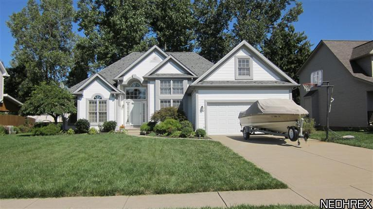 9147 Brian St, North Ridgeville, Ohio, 44039, SOLD HOME, 3 Bedroom, 2.5 Baths, contemporary ranch, full basement, finished basement rec room, large wooded lot, deck, gas heat, central air, 2 car attached garage, great room, open floor plan, $189000