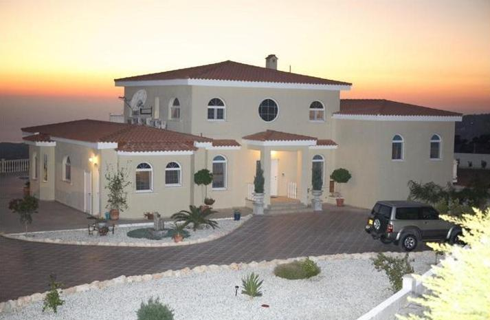 Akoursos Villa with plenty of curb appeal
