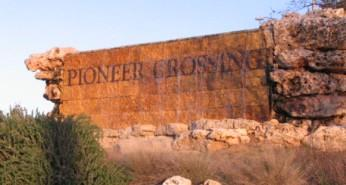 Sign at the entry to Pioneer Crossing West at Dessau and E. Braker Ln.