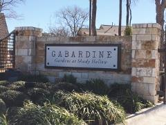 Sign at the entrance to Gabardine Gardens in S-SW Austin.