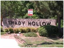 Sign at the north entrance to Shady Hollow on Brodie Lane.