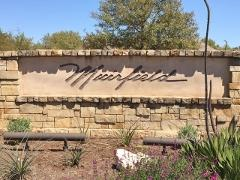 Sign at the entrance to Muirfield (Circle C Ranch) Subdivision from SH-45