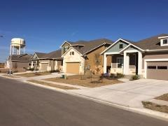 A street view of new homes in the StoneRidge neighborhood in Buda