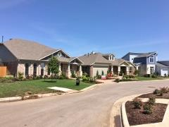 A view of model homes in Easton Park 78744