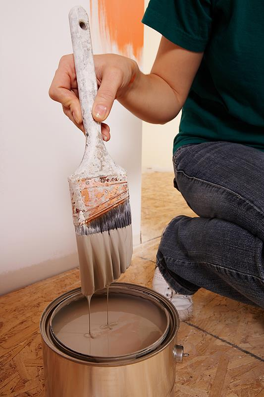 Person painting to prepare for selling their Massachusetts home