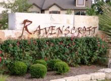 The monument at the Manchaca Rd. entry to Ravenscroft townhome development in South Austin