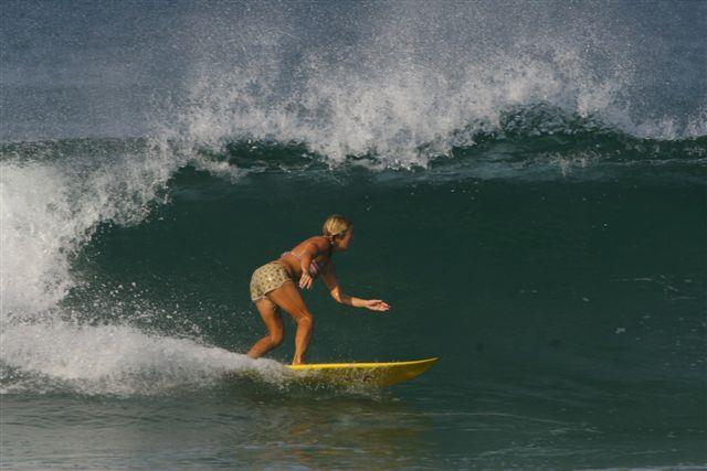 surfer riding wave in playa grande costa rica
