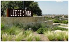 The sign at the entry to Ledge Stone from US-290 W.
