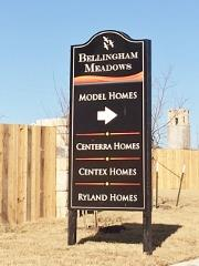 Sign pointo to the model home park in Bellingham Meadows in Northeast Austin 78754