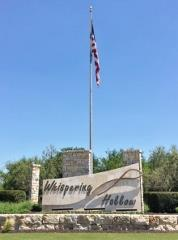 The flag monument at the entry to Whispering Hollow subdivision in Buda, TX!