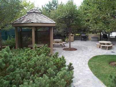 The Mansion condominiums 45 Kingsbridge Garden Cirlce and  55 Kingsbridge Garden Cirlce outdoor barbecue area