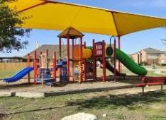 A view of the play equipment in Royal Pointe Park in Pflugerville.