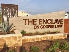 Sign at the entry to the Enclave on Cooper Lane neighborhood in South Austin