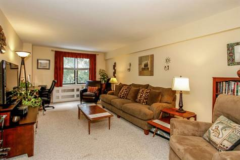 Step inside this lovely co-op and just unpack. Ffrom your living room enjoy treetop view.