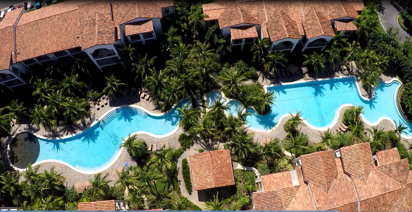 Aerial view of a freeform pool at a condo in Playas del Coco Costa Rica