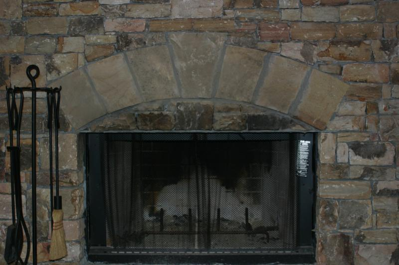 Curved header stone fireplace