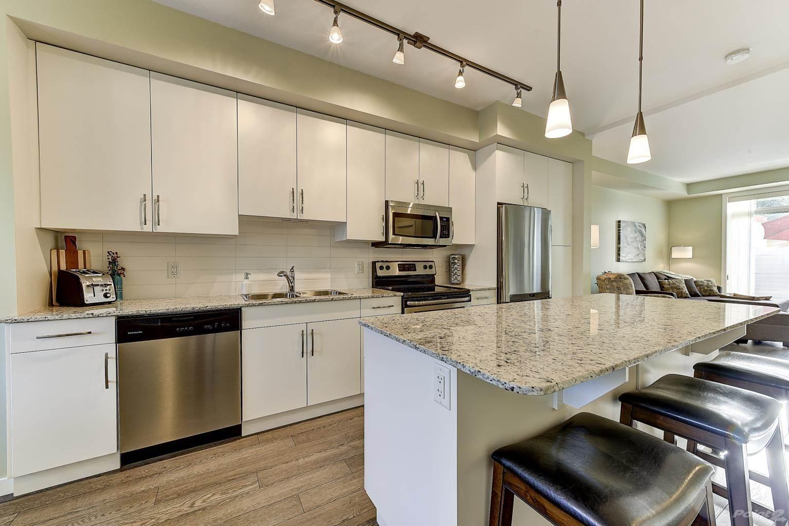 625 Boynton Place in Kelowna - Multifamily For Sale : MLS# 10221871 Photo 6