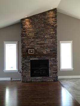 Halifax home builders - Hand built stone fireplace accentuates the vaulted ceiling