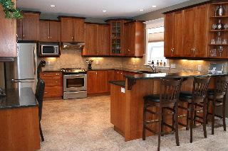 Handmade cherry kitchen cabinets by Countersink Construction - Russell Lake West